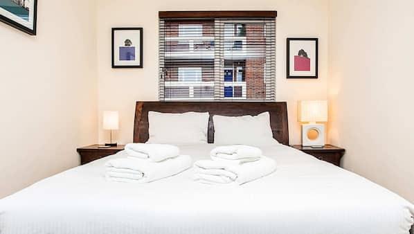 1 bedroom, premium bedding, laptop workspace, iron/ironing board