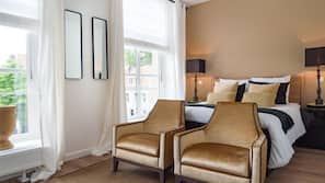 Premium bedding, free minibar, desk, free cots/infant beds