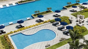 Outdoor pool, open 7:00 AM to 7:00 PM, free pool cabanas, pool umbrellas