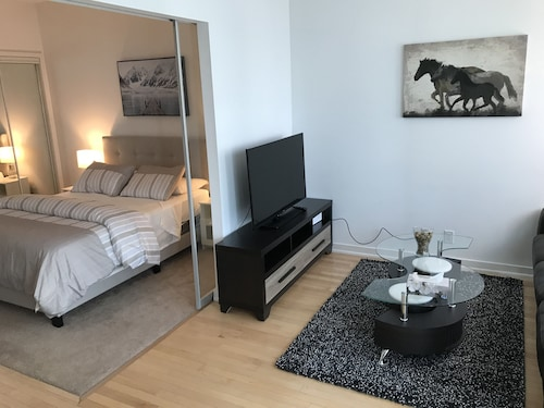 Check Expedia for Availability of High Rise 2BR next to Air Canada Ct