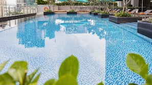 Outdoor pool, open 6 AM to 10 PM, pool umbrellas, pool loungers