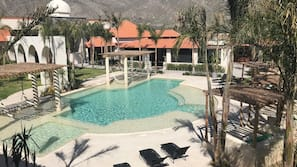 2 outdoor pools, open 10:00 AM to 11:00 PM, sun loungers
