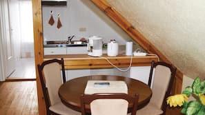 Fridge, stovetop, coffee/tea maker, cookware/dishes/utensils