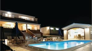 Outdoor pool, a heated pool, sun loungers