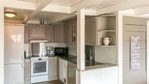 Fridge, dishwasher, coffee/tea maker, cookware/dishes/utensils