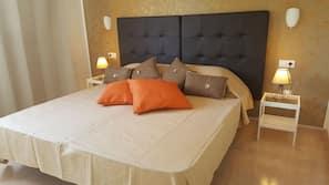 1 slaapkamer, verduisterende gordijnen, een strijkplank/strijkijzer