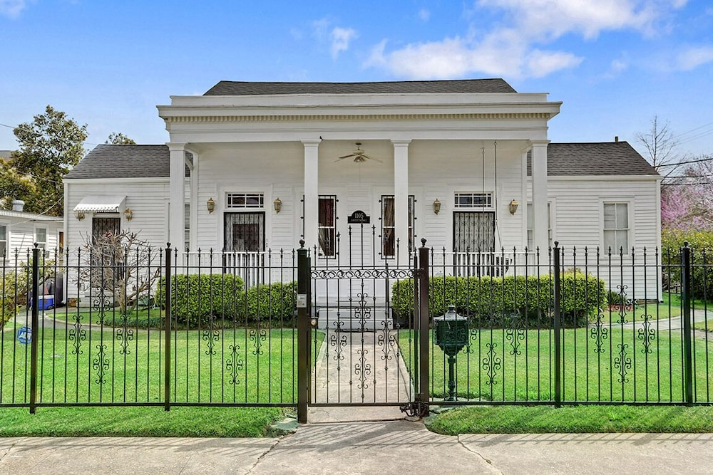 historic greek revival home in the riverbend around the corner from
