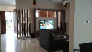 60-inch flat-screen TV with cable channels, DVD player