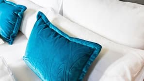 Premium bedding, in-room safe, blackout curtains, soundproofing