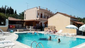Outdoor pool, open 9 AM to 8 PM, pool umbrellas, pool loungers