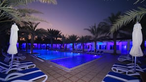 Outdoor pool, open 9:00 AM to 8 PM, pool umbrellas, sun loungers