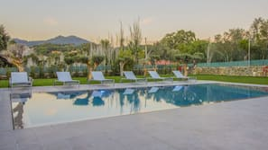 Outdoor pool, open 7:00 AM to 8:00 PM, pool umbrellas, sun loungers