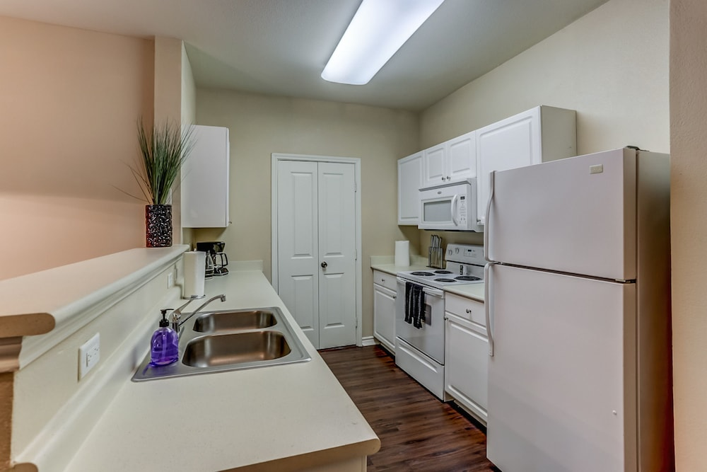 Private Kitchen, Apts at 49th by NamaStay