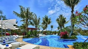 5 outdoor pools, open 7 AM to 10:30 PM, pool umbrellas, pool loungers