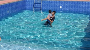 Seasonal outdoor pool, open 9 AM to 8 PM, pool loungers