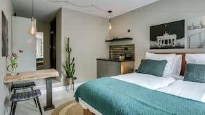 Een kluis op de kamer, een strijkplank/strijkijzer, gratis babybedden