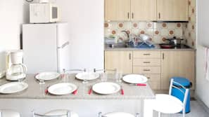 Fridge, microwave, stovetop, dining tables
