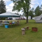 Relax in an Outfitter Tent Overlooking the Manistique River. Sleeps 4 on Cots