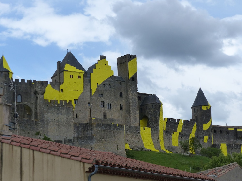 Little Troubadours At The Foot Of The Medieval City Of Carcassonne
