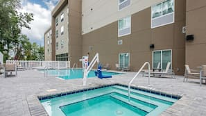 Outdoor pool, open 6 AM to 11 PM, pool umbrellas