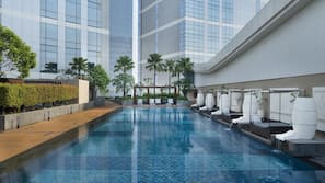 Outdoor pool, open 6:00 AM to 9:00 AM, cabanas (surcharge)