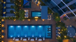 Outdoor pool, open 6:00 AM to 9:00 AM, pool cabanas (surcharge)