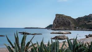 On the beach, sun loungers, beach umbrellas, motor boating