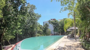 2 outdoor pools, an infinity pool, open 8 AM to 10 PM, pool umbrellas