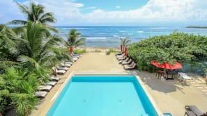 Outdoor pool, an aquatic center, pool umbrellas, sun loungers