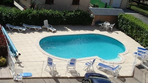 Outdoor pool, open 8 AM to 8 PM, pool umbrellas, sun loungers