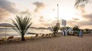 Private beach, white sand, beach towels