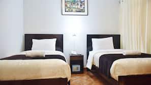 Roupas de cama premium, edredons de pluma, cofres nos quartos