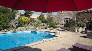 Seasonal outdoor pool, open 9:00 AM to 7:00 PM, pool umbrellas