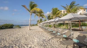 On the beach, free beach cabanas, sun loungers, beach massages