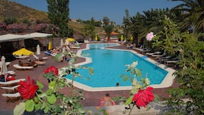 2 outdoor pools, a waterfall pool, open 8 AM to 8 PM, pool umbrellas