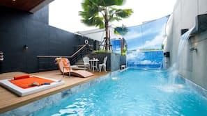 Outdoor pool, a waterfall pool, free pool cabanas, pool loungers
