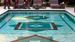 Outdoor pool, open 7:30 AM to 7 PM, pool umbrellas, pool loungers