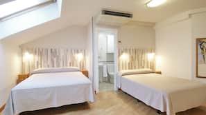Premium bedding, down comforters, in-room safe, laptop workspace