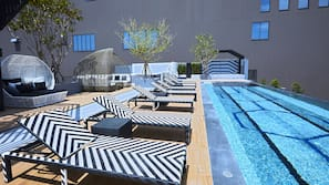 Outdoor pool, a rooftop pool, open 7 AM to 8 PM, pool loungers