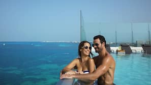 4 outdoor pools, open 8:00 AM to 8:00 PM, pool umbrellas, sun loungers