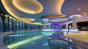 Indoor pool, open 7:00 AM to 11:00 PM, pool umbrellas, sun loungers