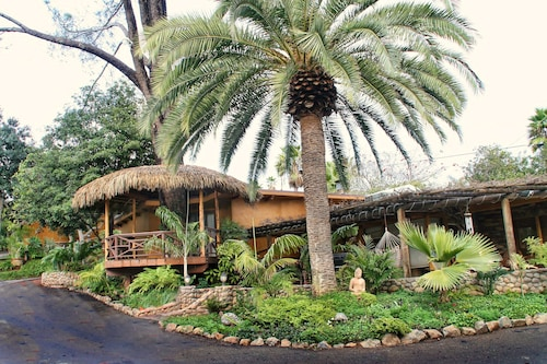 Surrounded by Waterfalls, Lush Gardens, Hammocks and Full Pool/bar-b-q Area
