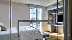 Premium bedding, memory-foam beds, desk, laptop workspace