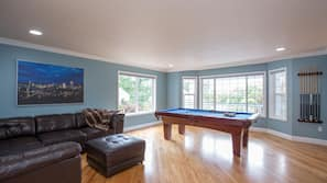 Flat-screen TV, fireplace, video-game console, foosball