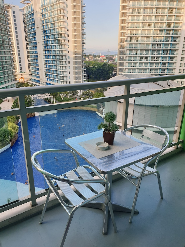 Balcony, Family Condo by IA @ Azure Urban Resort Residences