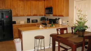 Fridge, oven, cookware/dishes/utensils