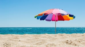 On the beach, sun loungers, beach towels, water skiing