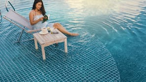Outdoor pool, open 5 AM to 10:00 PM, pool umbrellas, pool loungers