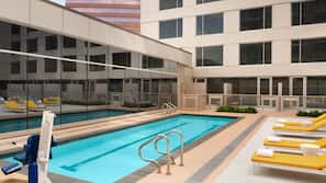 Outdoor pool, open 6:00 AM to 10:00 PM, pool loungers