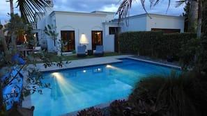 Seasonal outdoor pool, a heated pool, pool umbrellas, pool loungers